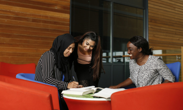 Students working in the mezzanine at the Business School.
